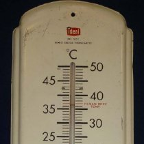 Image of Ideal School Supply Company Thermometer - This item is a thermometer produced by the Ideal School Supply Company located at 11000 LaVergne in Oak Lawn.  It is mostly white in color, and has markings for the temperature of the human body, room temperature and when water freezes.