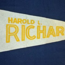 Image of Harold L. Richards High School Pennant - This item is a pennant from Harold L. Richards High School.  It is red, white and yellow in color, with the image of a bulldog on the left side.