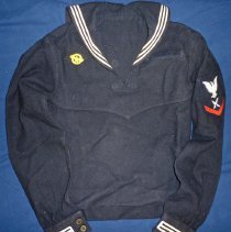 Image of United States Naval Uniform Top - This item is a naval uniform top used by Oak Lawn resident Lawrence Powers during his service in the Second World War.  The top is blue and white in color, with several different marking and insignias.