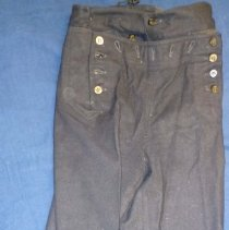 Image of United States Naval Uniform Pants - This item is a pair of naval uniform pants used by Oak Lawn resident Lawrence Powers during his service in the Second World War.  They are blue in color and have a number of buttons near the top.