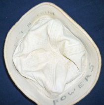 """Image of United States Naval Uniform Cap - This item is a naval uniform cap used by Oak Lawn resident Lawrence Powers during his service in the Second World War.  It is white in color and has the name """"Powers"""" written on the inside."""