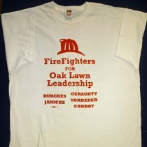 Image of Firefighters for Oak Lawn Leadership T-Shirt - This item is a Firefighters for Oak Lawn Leadership T-Shirt, and was given out during the 2009 Oak Lawn elections. The Oak Lawn Leadership Team consisted of Jerry Hurckes for Mayor, Debbie Janicke for Clerk, Dan Geraghty for Trustee, Terry Vorderer for Trustee and Joe Conroy for Trustee. This team would ultimately lose the elections.