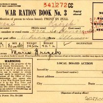 Image of War Ration Book No. 3 - This item is a war ration book issued during the Second World War. It was owned by Marie Krizek, and still contains most of the stamps inside.