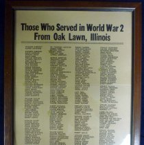 Image of Framed Listing of WWII Oak Lawn Veterans - This item is a framed listing of Oak Lawn World War Two veterans. It contains the names of all those who served, with a gold star next to those who were killed in action. The frame was presented to the Oak Lawn Public Library in July of 1947 by the Oak Lawn World War Two Plaque Committee. There is a small tag on the back that lists Charles Hart as Chairman, Dick Tweedie as Treasurer, Agnes Smutney as Secretary and George Linhart, Gordon Burk and Gertrude Skinner as members.