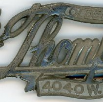 Image of Jack Thompson Dealership Nameplate - This item is a car nameplate from the Jack Thompson Dealership located at 4040 West 95th Street in Oak Lawn.  At the time, they specialized in selling Oldsmobile.  The nameplate is silver in color.