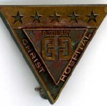 Image of Women's Auxiliary Pin - This item is a pin from the Women's Auxiliary at Christ Community Hospital, now known as Advocate Christ Medical Center. The front features five stars running across the top.