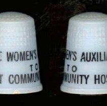 Image of Christ Community Hospital Thimble - This item is a thimble promoting the Women's Auxiliary at Christ Community Hospital.  It is blue in color and has black lettering.