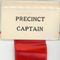 Image of Worth Township Regular Republican Organization Ribbon - This item is a ribbon used by Precinct Captain Ronald L. Larson, a committeeman of the Worth Township Regular Republican Organization.  The ribbon is red in color with gold lettering, and has a id card at the top.