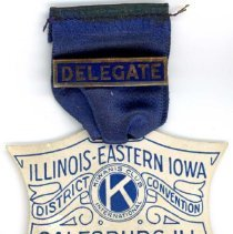 Image of Kiwanis Delegate Ribbon, 1924 - This item is a 1924 Kiwanis delegate ribbon used by Raymond S Blunt.  The convention took place in Galesburg, IL, and the item is blue in color, featuring images of Lincoln and Douglas.