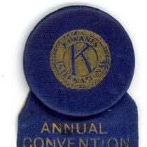 Image of Kiwanis Delegate Ribbon, 1927 - This item is a 1927 Kiwanis delegate ribbon used by Oak Lawn resident Raymond S Blunt.  The convention took place in Champaign, IL, and the item is blue in color with gold lettering.