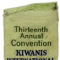 Image of Kiwanis Delegate Ribbon, 1929 - This item is a 1929 Kiwanis delegate ribbon used by Oak Lawn resident Raymond S Blunt.  The convention took place in Milwaukee, and the item is green in color with an image of Wisconsin.