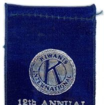 Image of Kiwanis Delegate Ribbon, 1929 - This item is a 1929 Kiwanis delegate ribbon used by Oak Lawn resident Raymond S Blunt.  The convention took place in Peoria, IL, and the item is blue in color with silver lettering.
