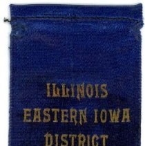 Image of Kiwanis Delegate Ribbon, 1930 - This item is a 1930 Kiwanis delegate ribbon used by Oak Lawn resident Raymond S Blunt.  The convention took place in Springfield, IL, and the item is blue in color with gold lettering.