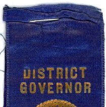 Image of Kiwanis Delegate Ribbon, 1936 - These items are 1936 Kiwanis delegate ribbons used by Oak Lawn resident Raymond S Blunt. The convention took place in Washington, and the items are blue in color with gold lettering.