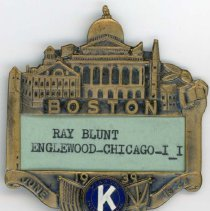 Image of Kiwanis Delegate Pin, 1939 - This item is a 1939 Kiwanis delegate pin used by Oak Lawn resident Raymond S Blunt. The convention took place in Boston, and the item is bronze in color, featuring an image of Boston's capital building.