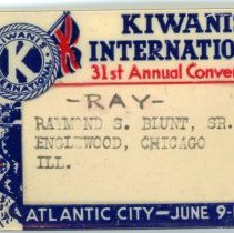Image of Kiwanis Delegate Pin, 1946 - This item is a 1946 Kiwanis delegate pin used by Oak Lawn resident Raymond S Blunt. The convention took place in Atlantic City, and the item is tan in color, featuring the Kiwanis logo in the upper left corner.
