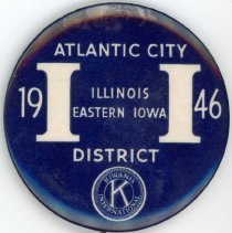 Image of Kiwanis Delegate Pin, 1946 - This item is a 1946 Kiwanis delegate pin used by Oak Lawn resident Raymond S Blunt. The convention took place in Atlantic City, and the item is blue in color with white lettering.