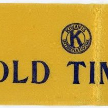 Image of Kiwanis Delegate Ribbon - This item is a Kiwanis delegate ribbon used by Oak Lawn resident Raymond S Blunt. The item is yellow in color with blue lettering.