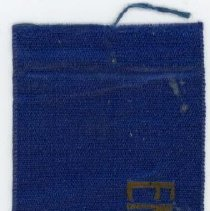Image of Kiwanis Delegate Ribbon - This item is a Kiwanis delegate ribbon used by Oak Lawn resident Raymond S Blunt. The item is blue in color with gold lettering.
