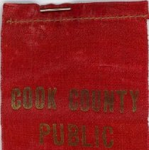 Image of Cook County Public Schools Spelling Contest Ribbon, 1916 - This item is a perfect score ribbon given out at the Third Annual Cook County Public Schools Spelling Contest in 1916.  It is red in color with gold lettering.