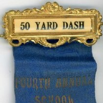 Image of Fourth Annual School Festivals Ribbon, 1916 - This item is a 50 yard dash ribbon given out at the Fourth Annual Cook County School Festivals in 1916.  It is blue in color with gold lettering, and was won by Oak Lawn resident Dorothy Elvidge Bown.