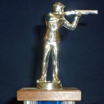 Image of Cook County Council Trap Shoot Trophy, 1969 - This item is a 1st place trophy from the 1969 Cook County Council trap shoot event.  George Probst, who won the trophy, attended the contest with other members of the Oak Lawn Sportsmen's Club.  It features a small statue at the top depicting a hunter holding his weapon.  The club was located at 107th Street and Central Avenue in Oak Lawn.