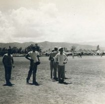 Image of World War II Photograph - This is a photograph taken in the Pacific Theater during the Second World War. It features a group of soldiers standing in an airfield, and may have been snapped in the Philippine Islands.