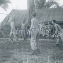 Image of World War II Photograph - This is a photograph taken in the Pacific Theater during the Second World War. It features a group of soldiers playing volleyball, and may have been snapped in the Philippine Islands.