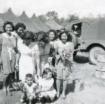 Image of World War II Photograph - This is a photograph taken in the Pacific Theater during the Second World War. It features a group of native women and children posing, and may have been snapped in the Philippine Islands.