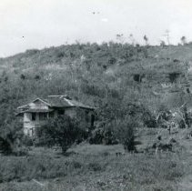 Image of World War II Photograph - This is a photograph taken in the Pacific Theater during the Second World War. It features a building on a hillside, and may have been snapped in the Philippine Islands.