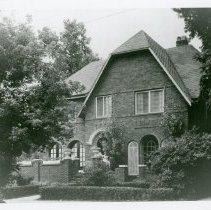 Image of 9530 S. 53rd Avenue Residence - This is a photograph of the O'Brien Courthouse. It is located at 9530 South 53rd Avenue and was built around 1927. The home was constructed by early Police Magistrate and Justice of the Peace Frank J. O'Brien and his wife Mary (Mabel). Four people can be seen in the photo, a boy sitting on the on the wall next to the large planter on the left side of the front stairs, another boy and girl sitting on the wall next to the large planter on the right side of the front stairs, and a little girl standing on a walkway next to the house in the very right of the picture. All are unidentified. The home was declared a historical landmark by the Oak Lawn Historic Preservation Commission.