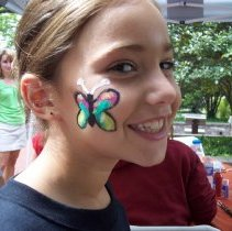 Image of 2009 Fall on the Green - This is a photograph of the 2009 Oak Lawn Fall on the Green celebration.  It features a child with a face paint butterfly.