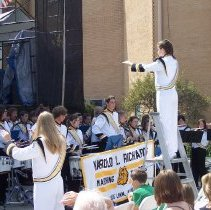 Image of 2009 Fall on the Green - This is a photograph of the 2009 Oak Lawn Fall on the Green celebration.  It features the Harold L. Richards High School marching band and the library in the background.