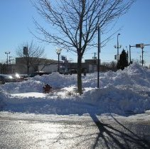 Image of 2011 Snow Storm - This is a photograph of the 2011 snow storm that struck the Chicagoland area.  It features a pile of snow near a parking lot at 95th Street and Cook Avenue.
