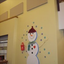 Image of 2011 Snow Storm - This is a photograph of the 2011 snow storm that struck the Chicagoland area.  It features an interior view of the library and a large decorative snow man.
