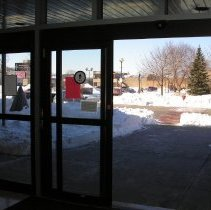 Image of 2011 Snow Storm - This is a photograph of the 2011 snow storm that struck the Chicagoland area.  It features an interior view of the library and snow around Raymond Avenue.