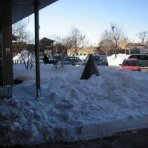 Image of 2011 Snow Storm - This is a photograph of the 2011 snow storm that struck the Chicagoland area.  It features an exterior view of the library and snow around Raymond Avenue.