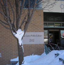Image of 2011 Snow Storm - This is a photograph of the 2011 snow storm that struck the Chicagoland area.  It features an exterior view of the library surrounded by piles of snow.