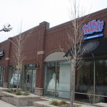Image of 95th Street Oak Lawn - This is a photograph of Eva's Bridal and Northern Border American Grill located on 95th Street between 53rd Avenue and Cook Avenue.  A new sign is being installed on Eva's Bridal.
