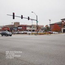 Image of 95th Street Oak Lawn - This is a photograph of Harris Bank, Smashburger, T Mobile, and Qdoba Mexican Grill located on the corner of 95th Street and 52nd Avenue. The community parking garage is visible in the rear.