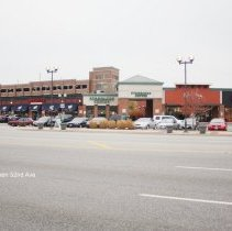 Image of 95th Street Oak Lawn - This is a photograph of T Mobile, Qdoba Mexican Grill, Starbucks Coffee, and Potbelly located on 95th Street between 52nd Avenue and Tully Avenue. The community parking garage and train station are visible on the left.