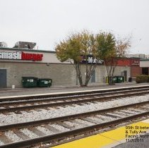 Image of 95th Street Oak Lawn - This is a photograph of the back of Smashburger and T Mobile, located on 95th Street between 52nd Avenue and Tulley Avenue, taken from the train station platform.