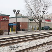 Image of 95th Street Oak Lawn - This is a photograph of the back of Qdoba Mexican Grill, Starbucks Coffee, and Potbelly, located on 95th Street between 52nd Avenue and Tulley Avenue, taken from the train station platform.
