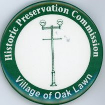 Image of Historic Preservation Commission Promotional Pin - This item is an Historic Preservation Commission promotional pin. It is green in color with white lettering and the image of a lamppost near the center.