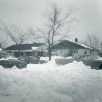 Image of 1967 Snowstorm - This is a photograph of the 1967 Snowstorm which blanketed the Chicago area, including Oak Lawn, with several feet of snow.  It was taken from 8736 South Sproat Avenue and features three cars stuck in the snow.