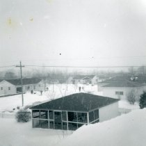 Image of 1967 Snowstorm - This is a photograph of the 1967 Snowstorm which blanketed the Chicago area, including Oak Lawn, with several feet of snow.  It was taken from the roof of the house at 8736 South Sproat Avenue and features a view of surrounding houses.
