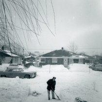 Image of 1967 Snowstorm - This is a photograph of the 1967 Snowstorm which blanketed the Chicago area, including Oak Lawn, with several feet of snow.  It was taken from the carport roof of the house at 8736 South Sproat Avenue and features a man shovelling snow.