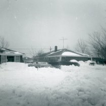 Image of 1967 Snowstorm - This is a photograph of the 1967 Snowstorm which blanketed the Chicago area, including Oak Lawn, with several feet of snow.  It was taken from 8736 South Sproat Avenue and features a neighbor's (Jone's) house.