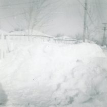 Image of 1967 Snowstorm - This is a photograph of the 1967 Snowstorm which blanketed the Chicago area, including Oak Lawn, with several feet of snow.  It was taken from the backyard of the house at 8736 South Sproat Avenue and features other homes covered in snow.