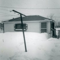 Image of 1967 Snowstorm - This is a photograph of the 1967 Snowstorm which blanketed the Chicago area, including Oak Lawn, with several feet of snow.  It was taken from 8736 South Sproat Avenue and features a neighbor's (Derro's) house.